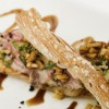 Toasted bread with pork collar pickled in Reineta apple puree, parmesan and arugula