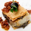 Cod millefeuille with black olive pâté and dried tomato vinaigrette